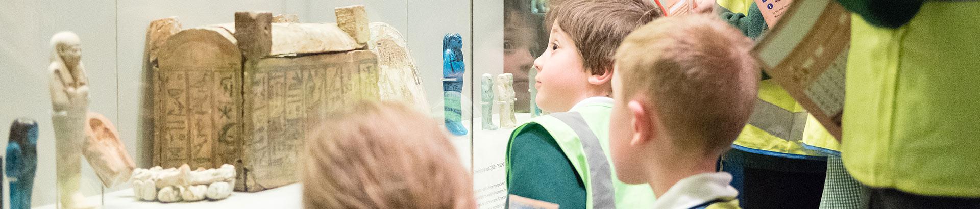 Children viewing Egyptian artefacts