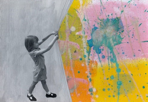 Abstract image of child pulling back material to show coloured splash paint