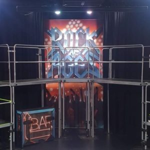Stage set with Rock of Ages signage